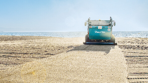 Trailed beach cleaner with tractor on beach